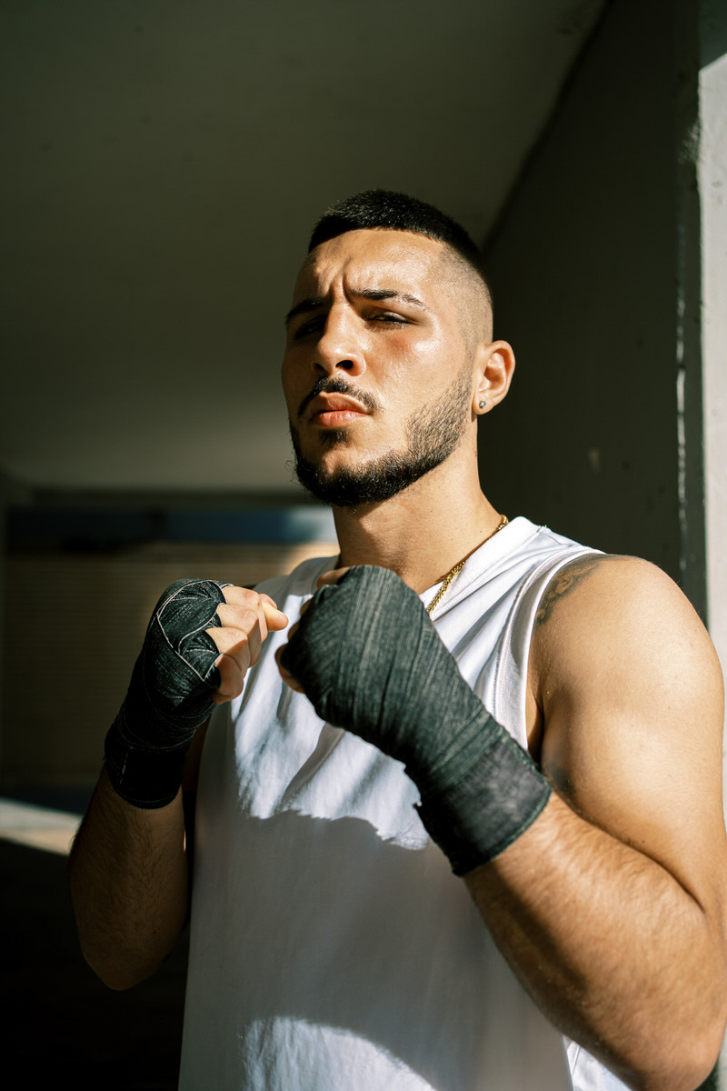 Sportsman with boxing wraps on hands