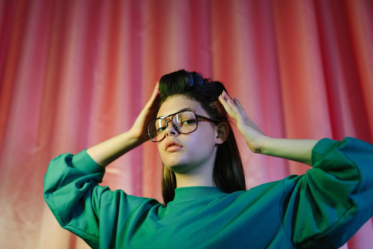 Flawless girl in hair curlers