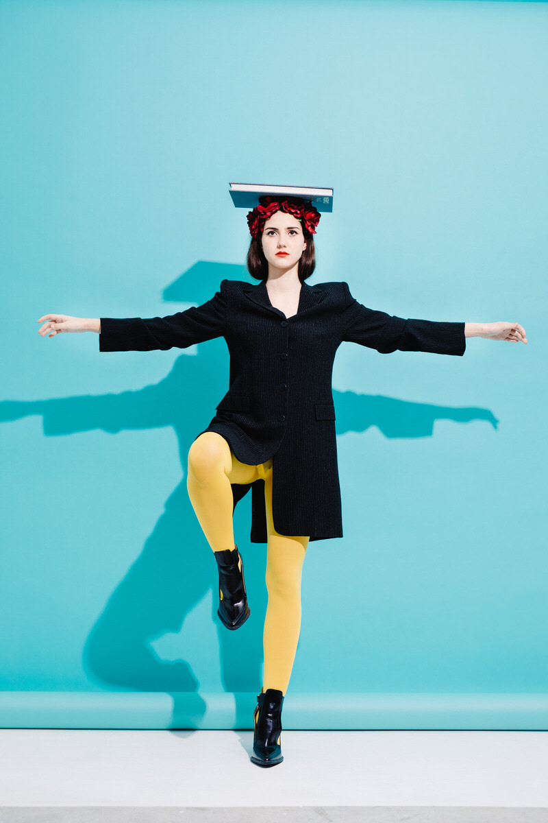 Woman balancing with book on head