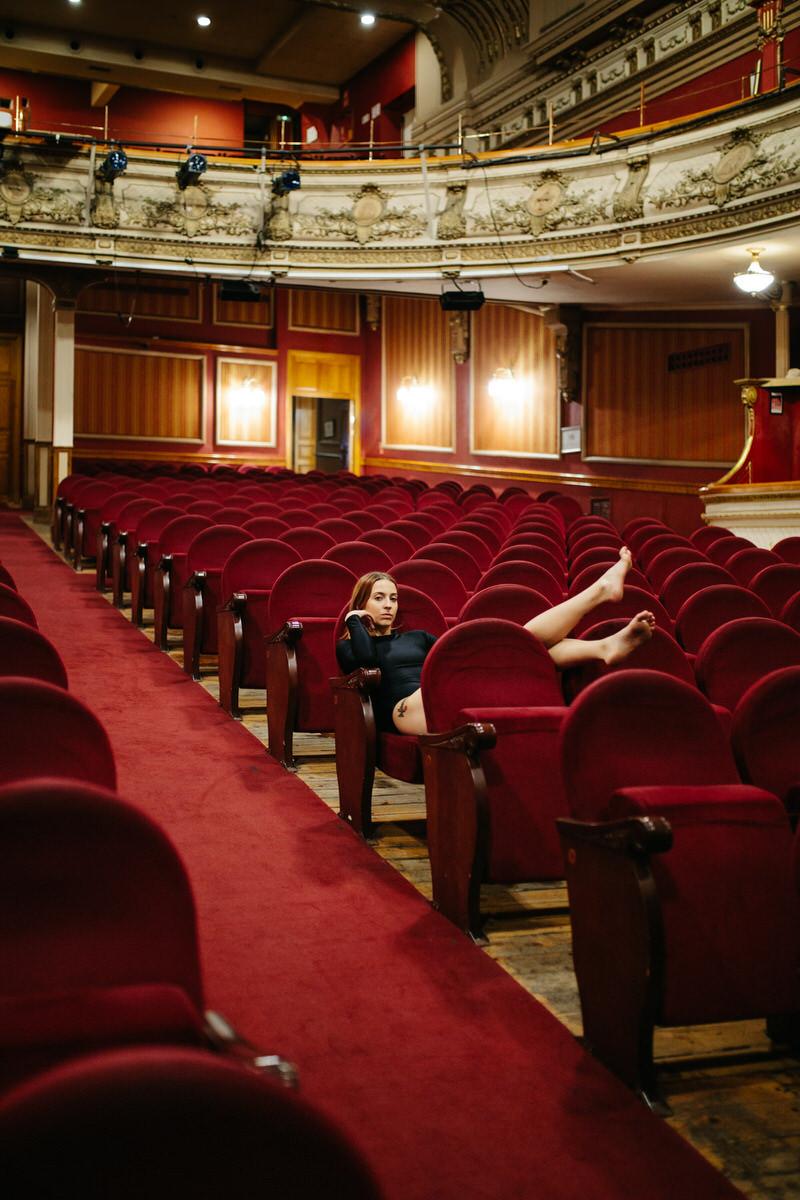 Dancer resting in auditorium