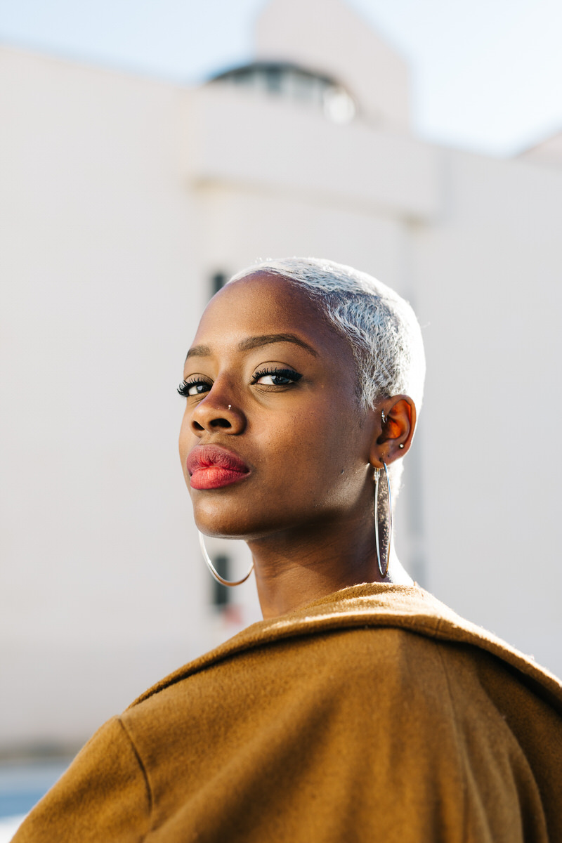 Gorgeous black woman looking at camera