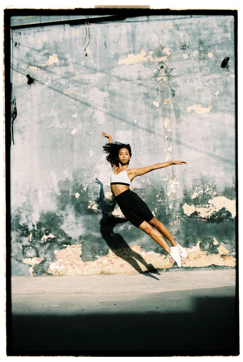 Fit woman dancing on street