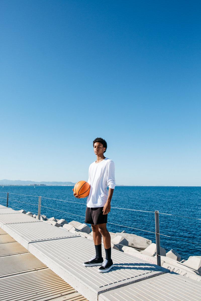 Basketball player at waterfront