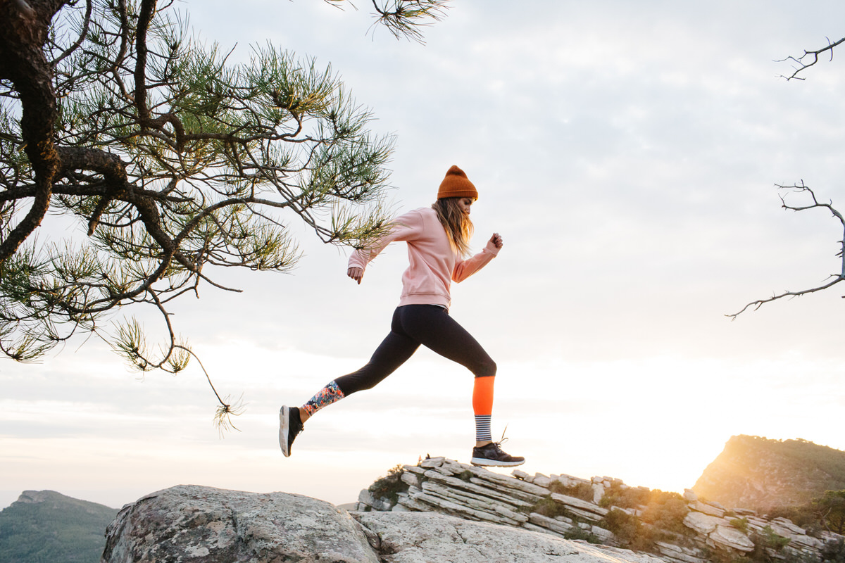 Woman jogging on hill