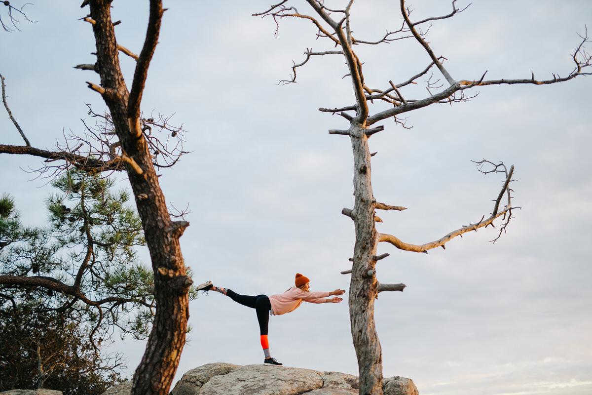 Woman stretching on hill