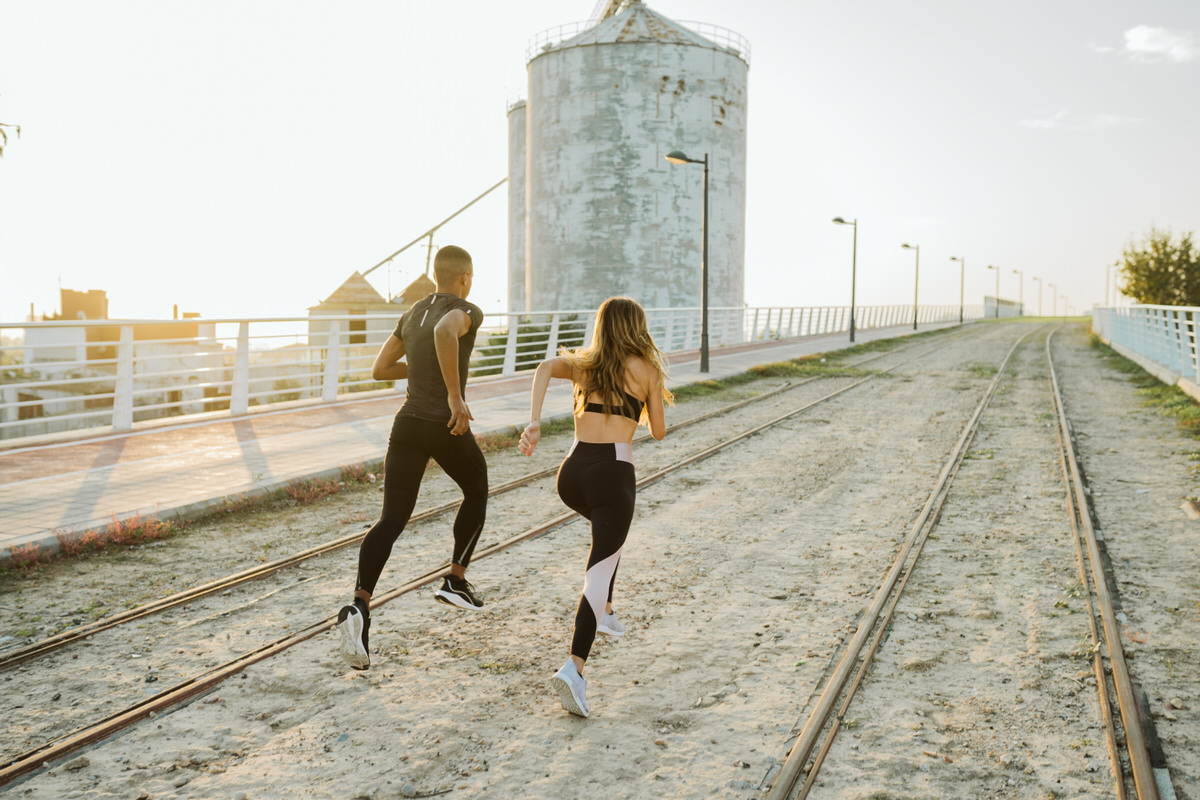 Strong people running on railroad