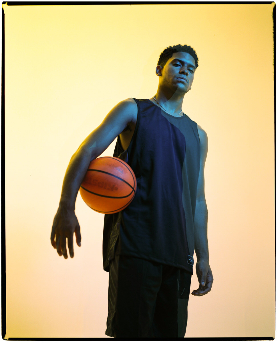 Determined black basketball player with ball