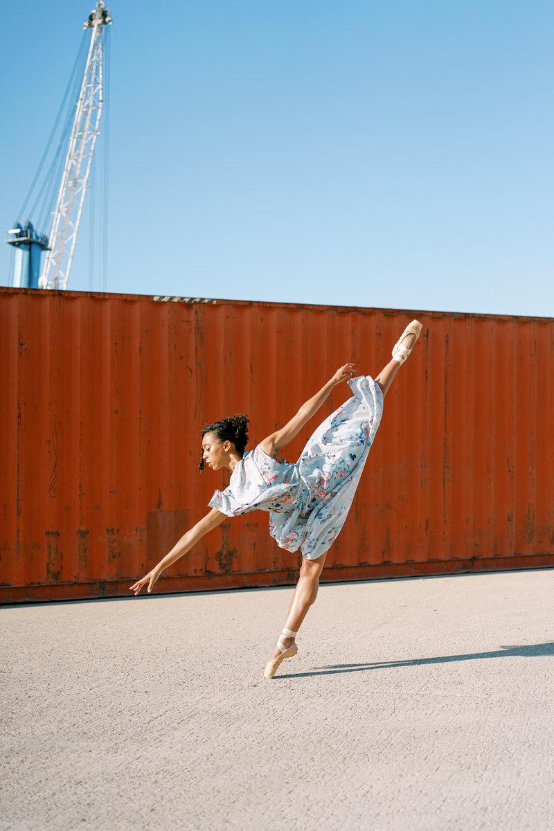Elegant ballerina in summer dress standing on tiptoe